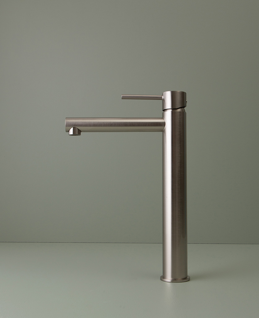 silver inga tap side angle shot on grey-green background
