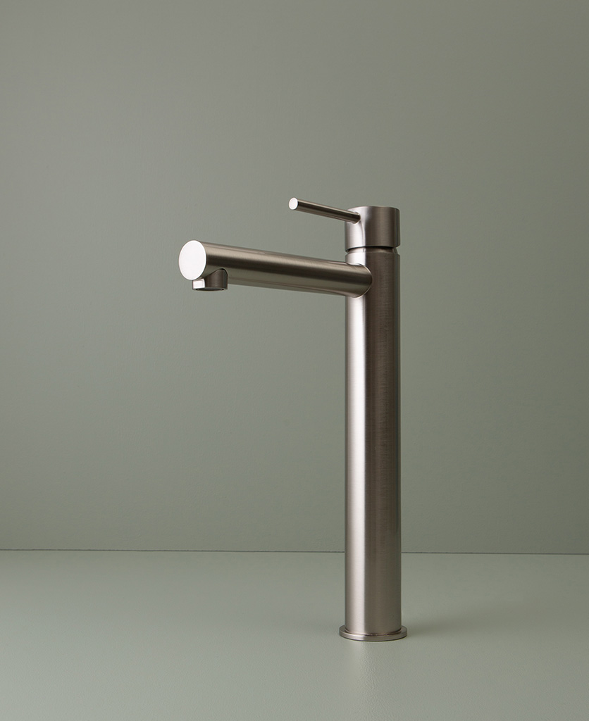 silver inga tap on green background