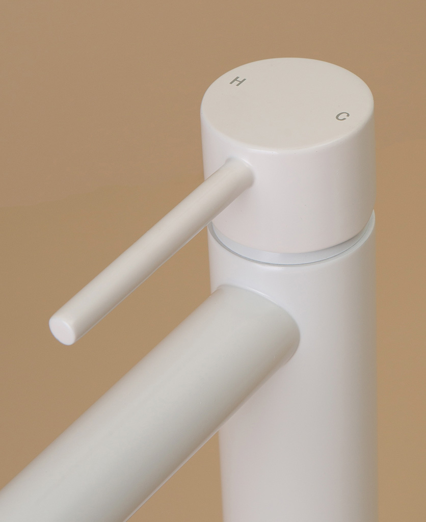 white inga tap close up of handle hot and cold