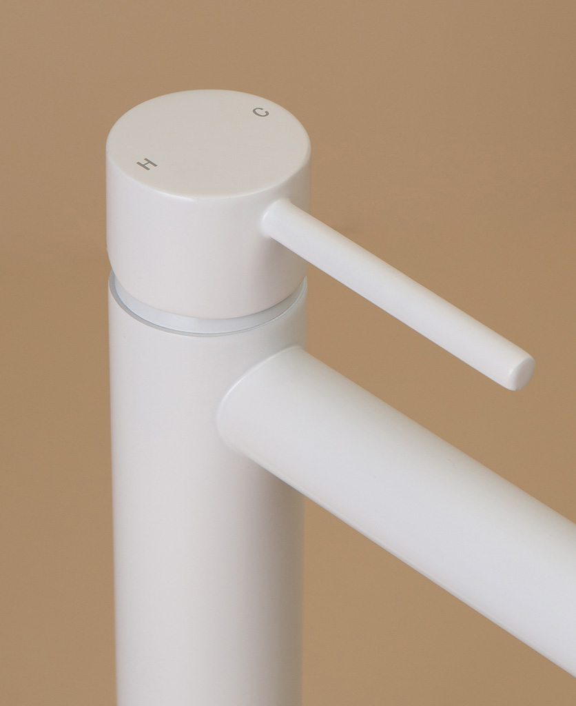 white kagera tap close up of handle hot and cold