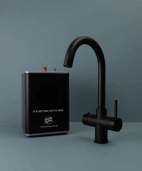 black monroe hot water tap with boiler on blue background