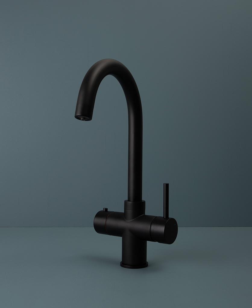 black monroe hot water tap on blue background