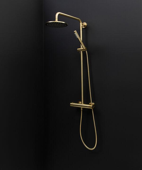 gold complete shower set on black background