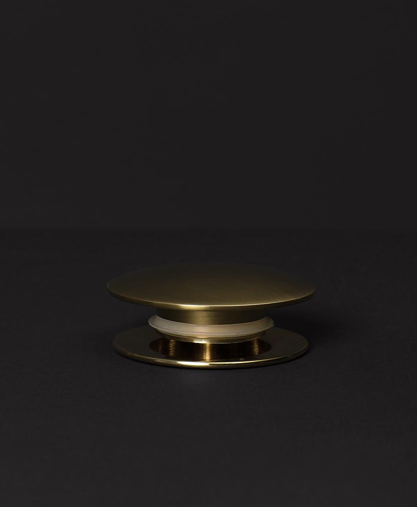 gold click clack waste on black background