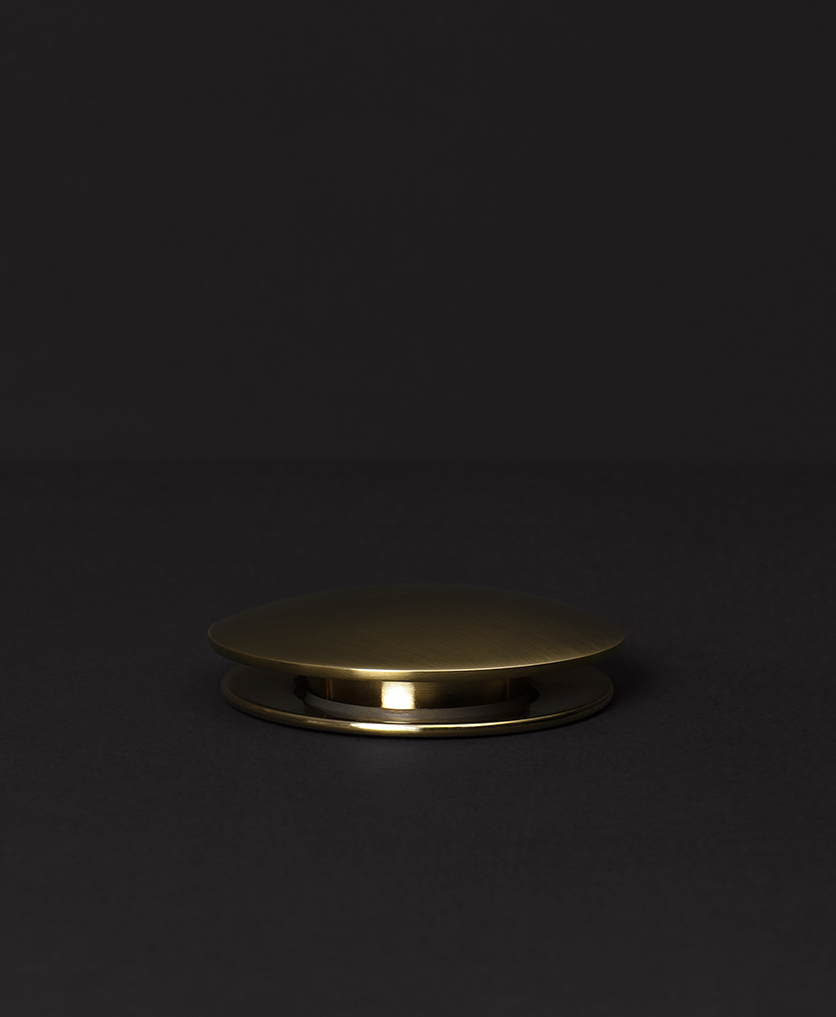 gold unslotted click clack waste on black background