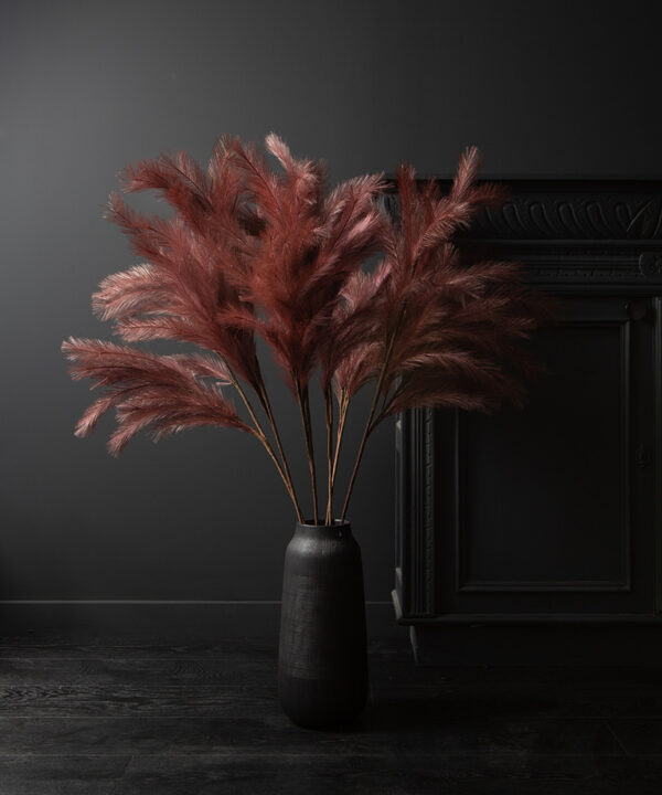 panicle grass in long black vase