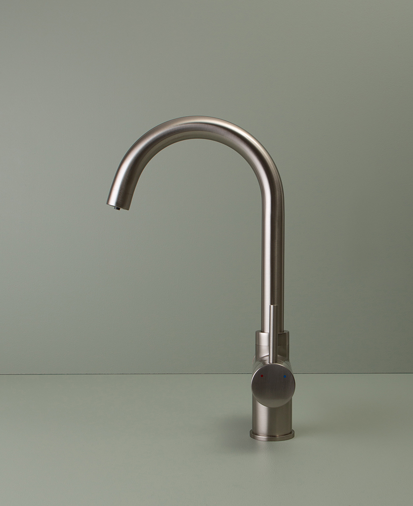 silver monroe hot water tap side angle on green background