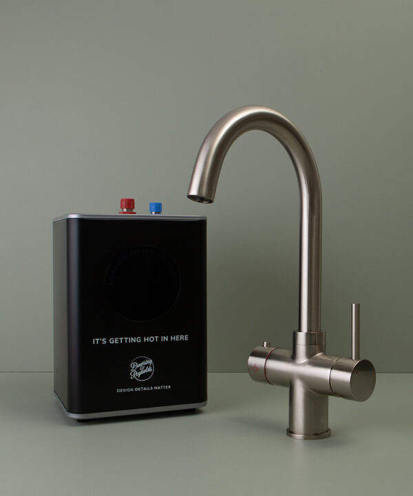 silver monroe hot water tap with boiler on green background