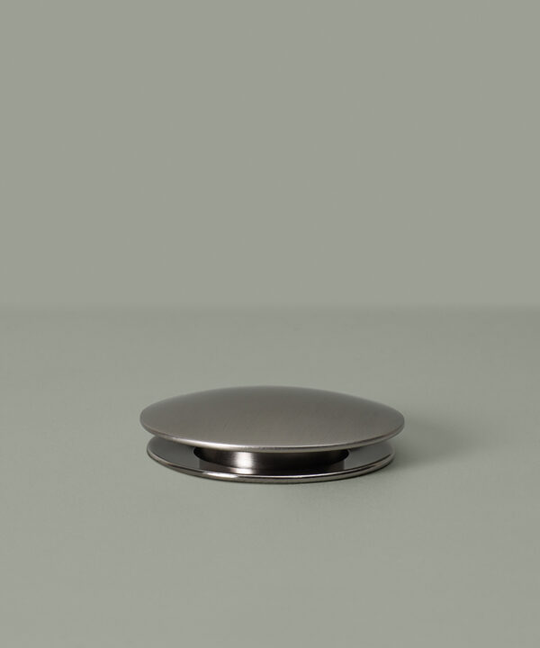 silver slotted click clack waste down on grey background