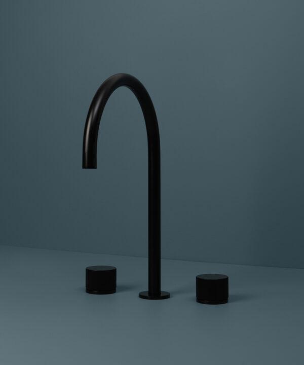 black reeded tap black reeded tap close up on blue background