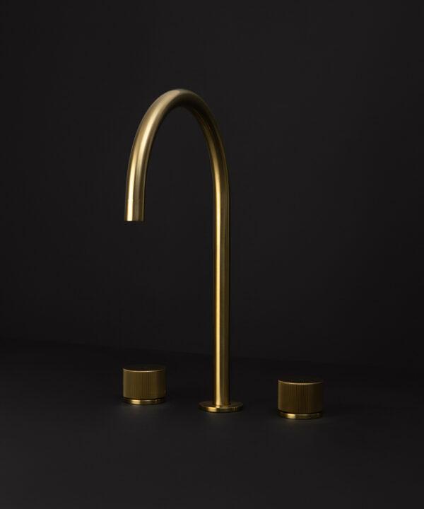 gold reeded tap gold reeded tap close up gold reeded tap close up of spout on black background