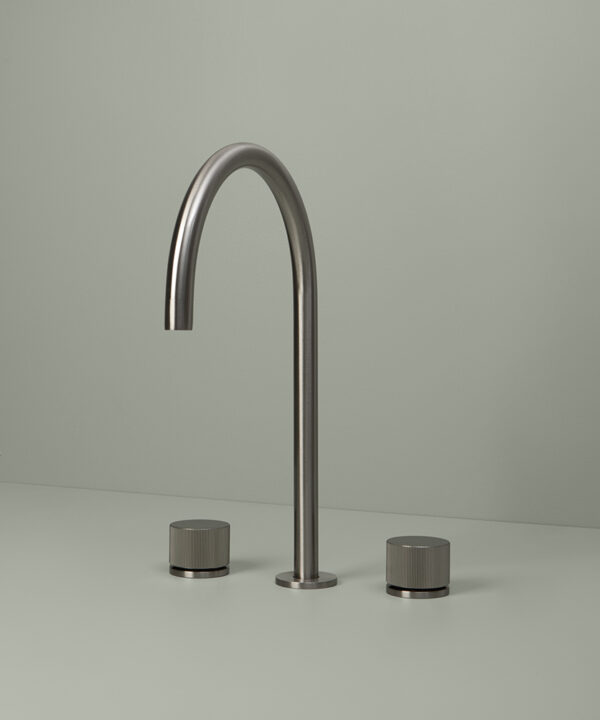 silver reeded tap on grey background