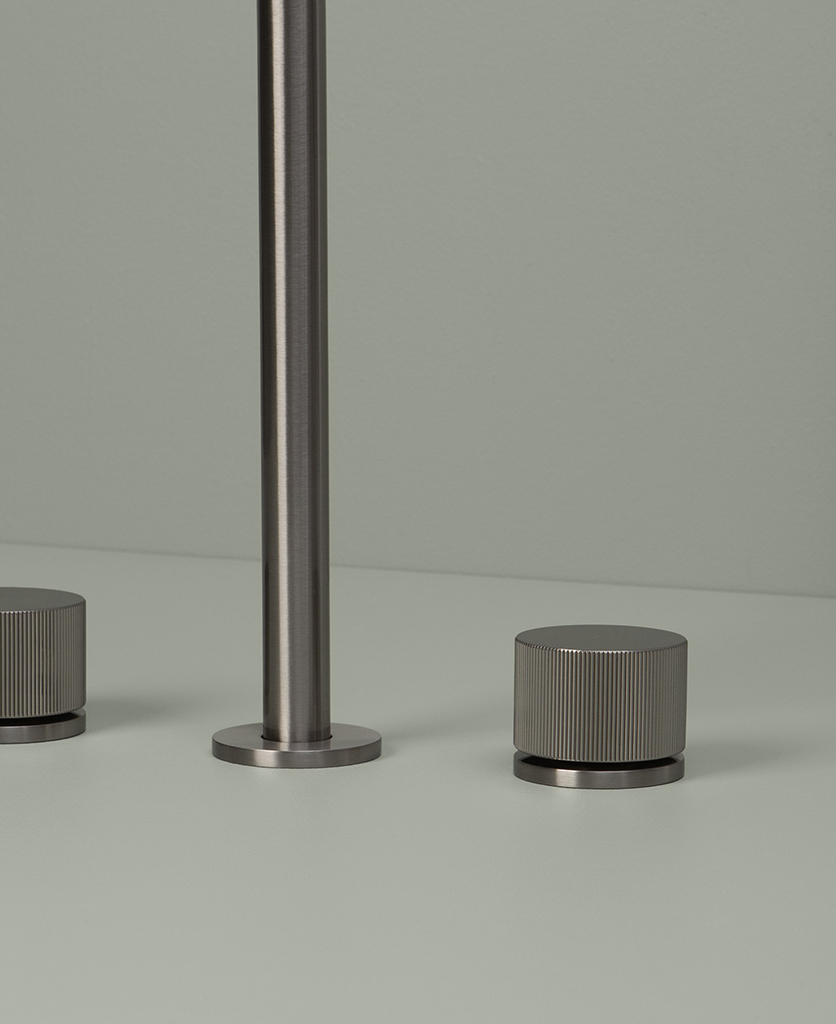 silver reeded tap close up on grey background