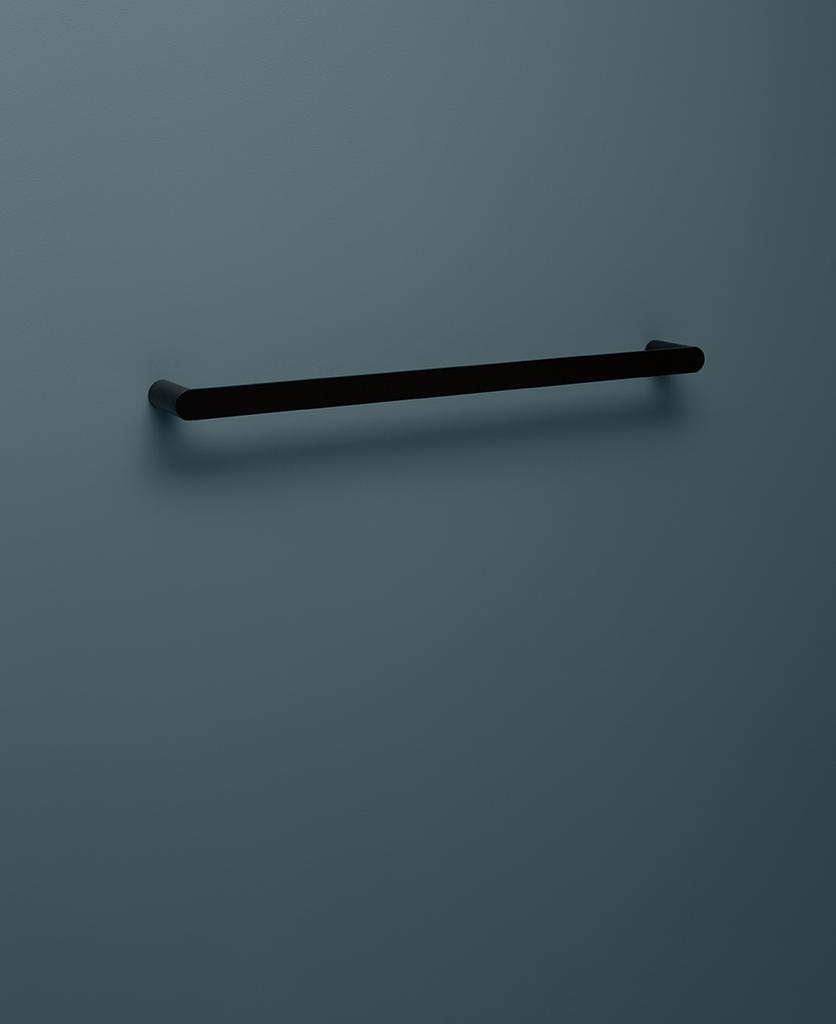 black towel rail on blue background