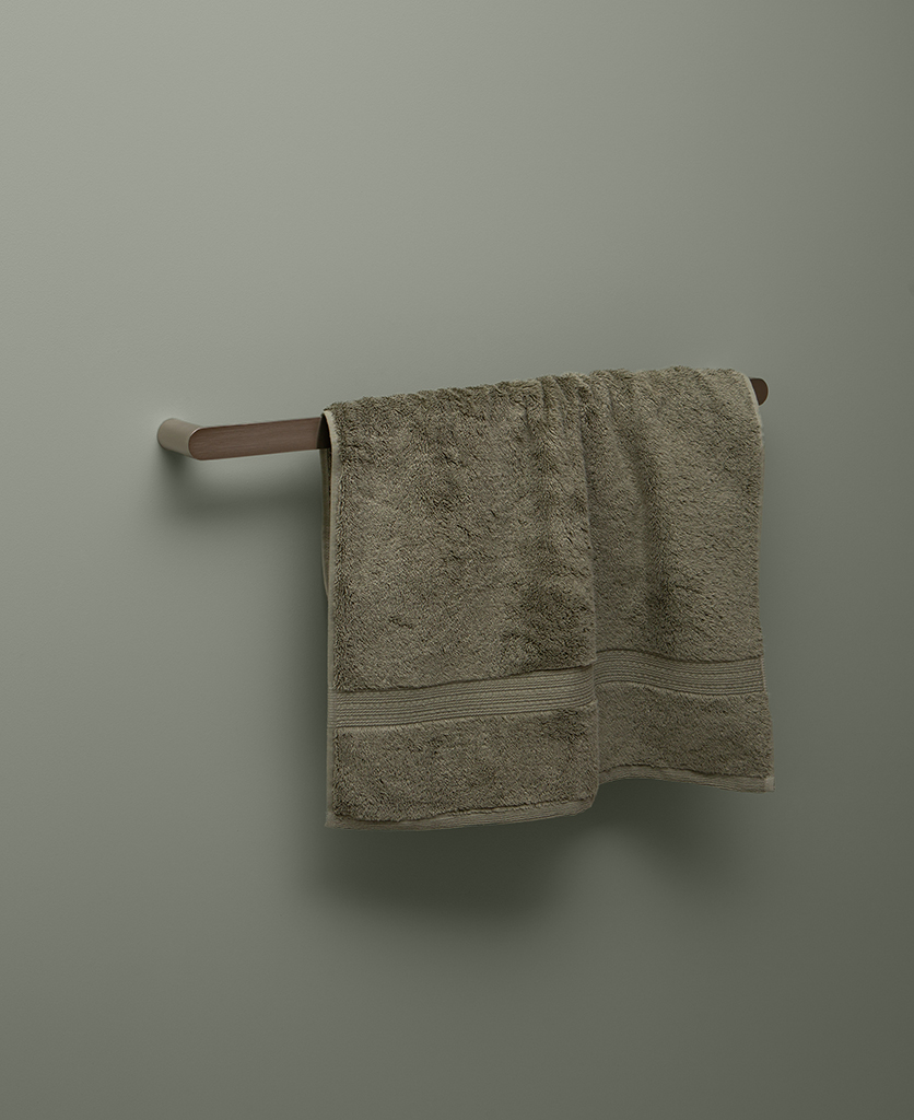 silver towel rail on grey background