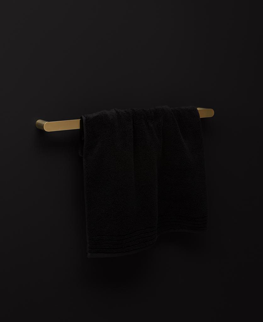 gold towel rail on black background