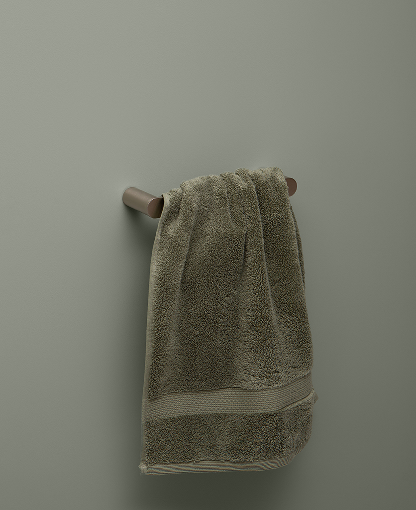 small silver towel rail on grey background
