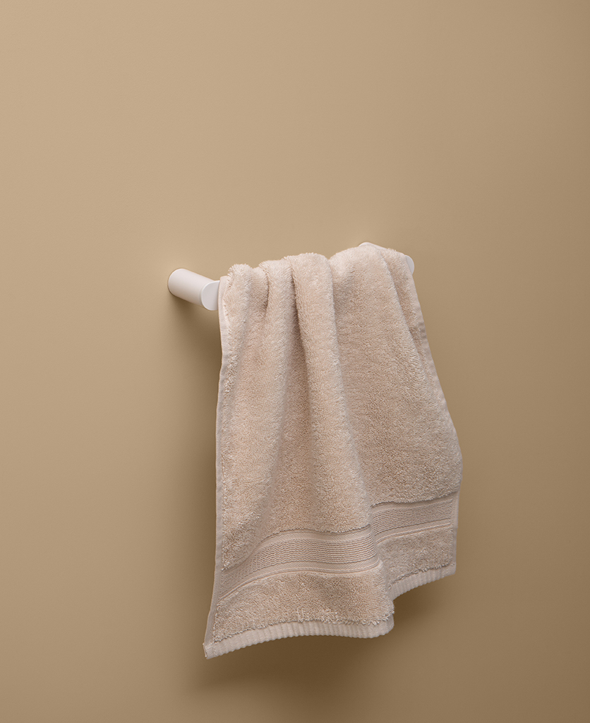 small white towel rail on peach background