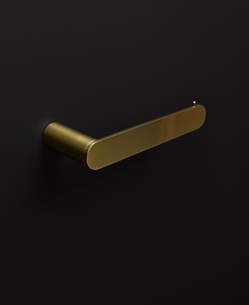 gold paper holder on black background
