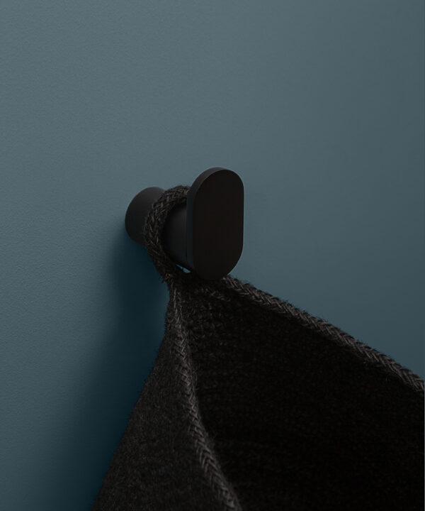 black robe hook on blue background