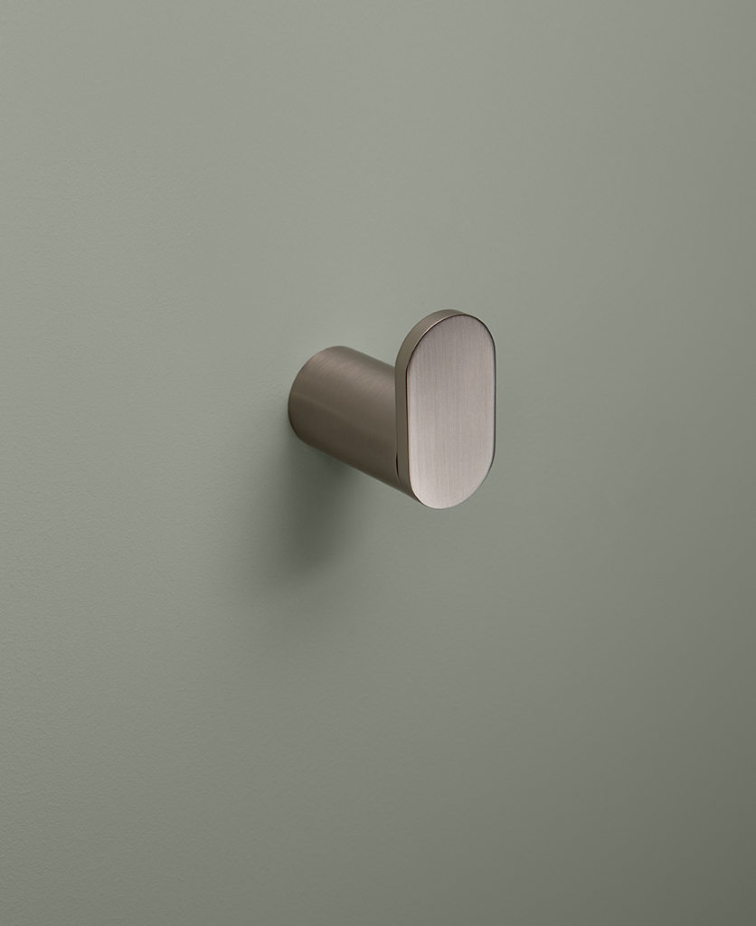 silver robe hook on grey background