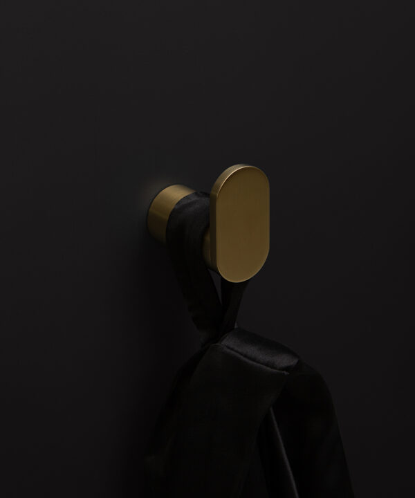 gold robe hook on black background